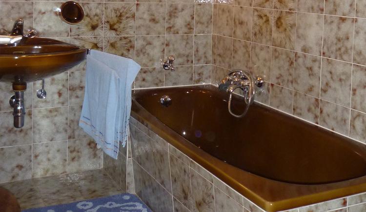 Bathroom with bath and washbasin