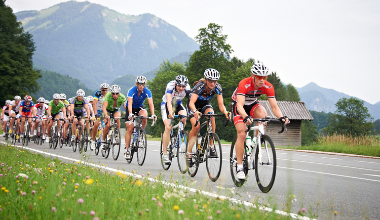 Cyclists on the road, in the background the mountains