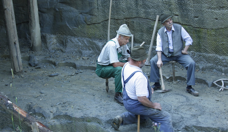 Three men work in the grindstone .