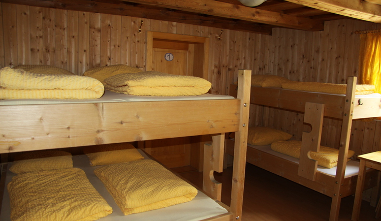 Enjoy the cosy guest rooms of the Lodge with bunk bed