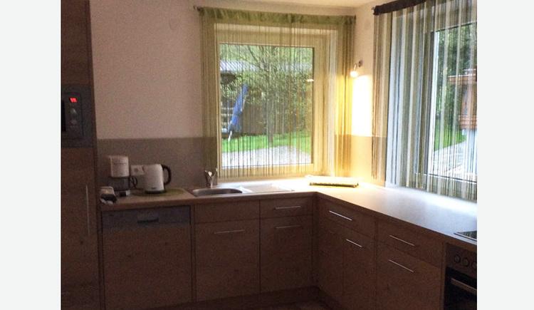 Kitchen, coffee machine, water cooker, dishwasher, in the background window