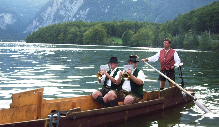 brass musicians on the flat boat