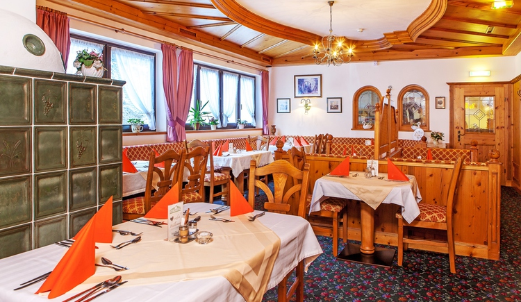 Comfortably furnished restaurant with tiled stove
