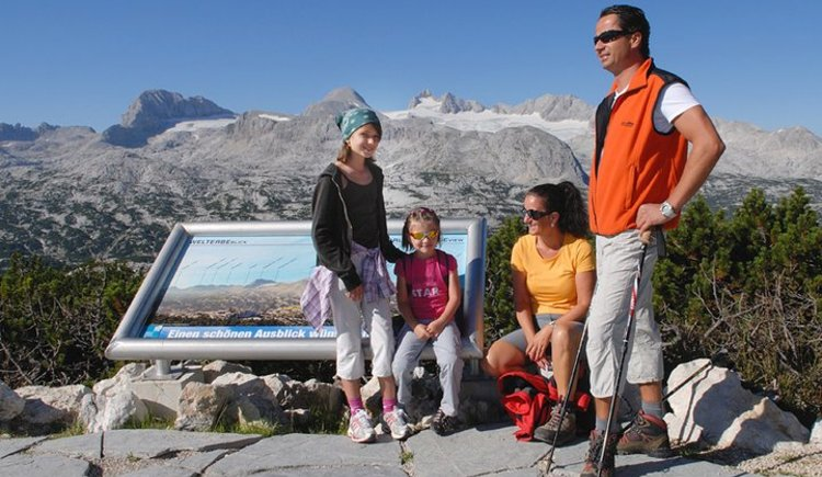 family with the breathtaking view of the Dachstein glacier