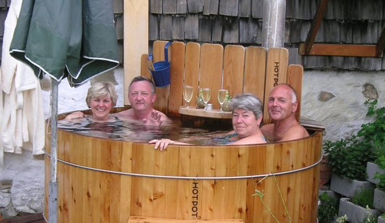 Two couples in an open-air bath-barrel