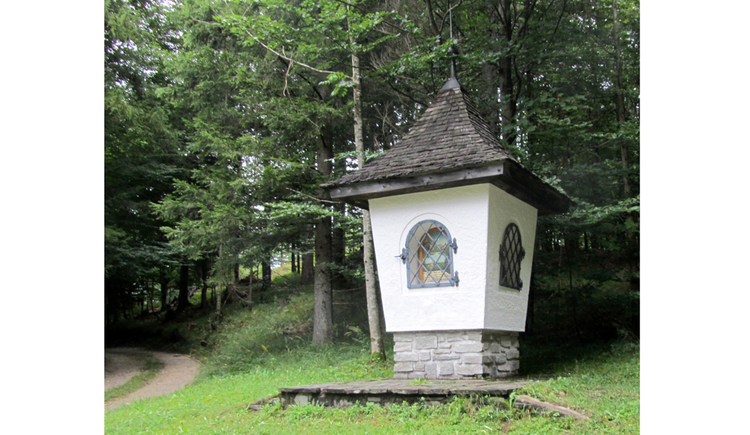 View of a wyside shrine on the edge of a forest