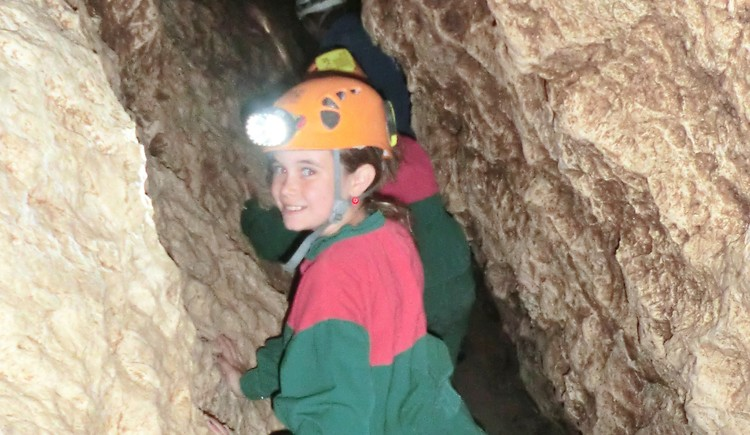 kids on an adventure tour in the cave