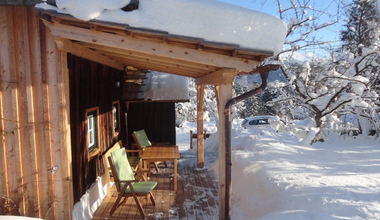 Enjoy the tranquility in the winter landscape on the covered terrace
