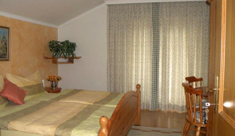 Schlafzimmer im Haus Rosenwinkl bei Familie Fanninger. Appartement in Strobl am Wolfgangsee
