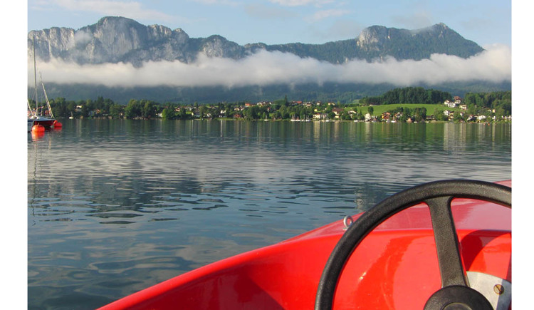 View from an electric boat to the lake and the mountains
