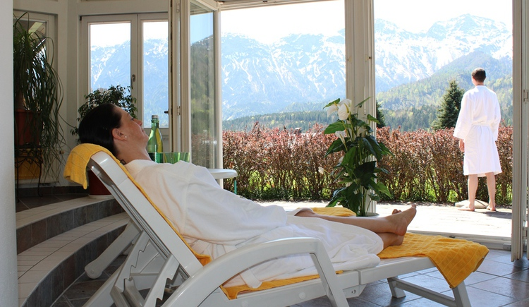 Relax in the hotel's wellness area with a magnificent view of the mountains