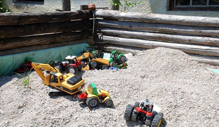 Fuhrpark im Sandkasten