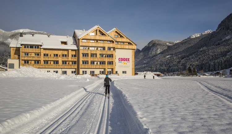 the hotel in the winter with cross-country skiing track