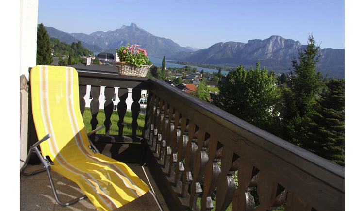 Balcony with deckchair, view of the landscape, mountain in the background
