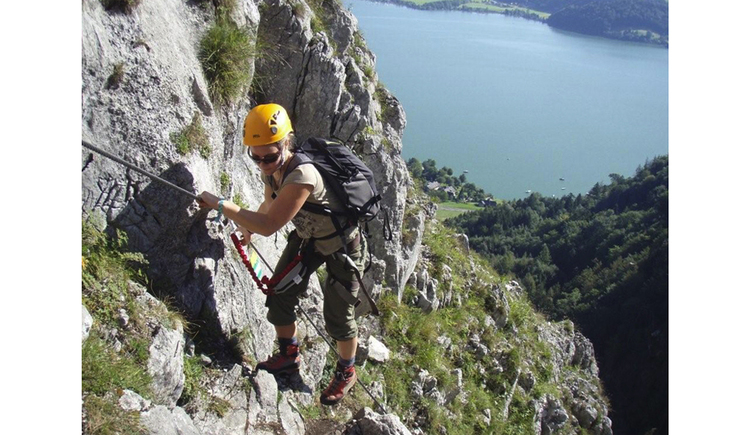 Person is on the via ferrata Drachenwand, lake