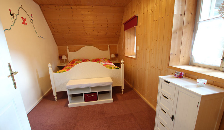 On the photo you see the sleeping room of the apartment Weißenbach in Bad Goisern.