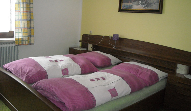Sleeping room inside the Apartment Brabenetz with a huge double bed