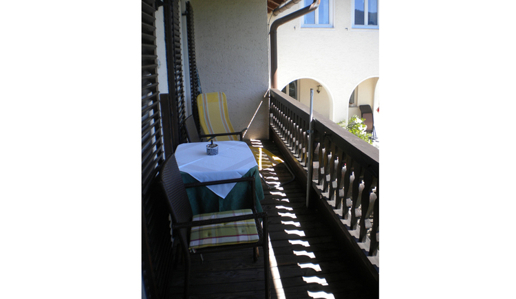 balcony with table and chairs, deckchair