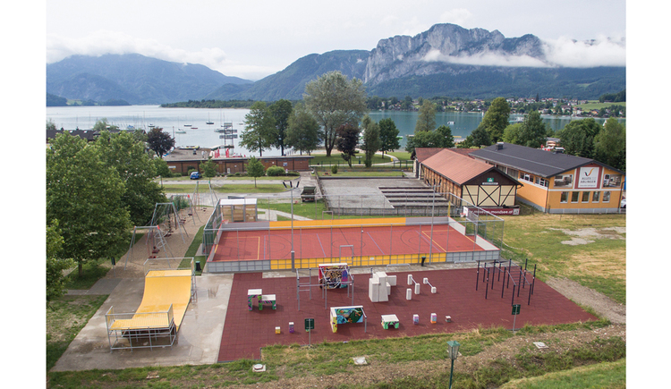 fitnesspark, in the Background the lake and mountains\n\n