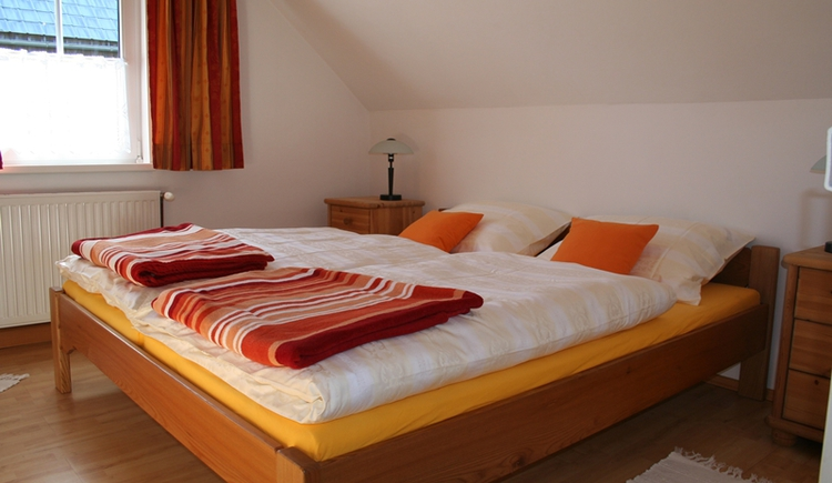 The cozy bed room with double bed in the holiday home Forstinger.