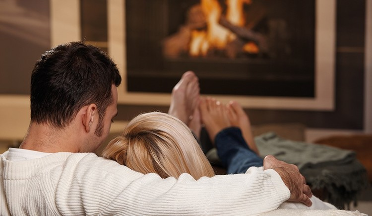 Couple in front of a chimney