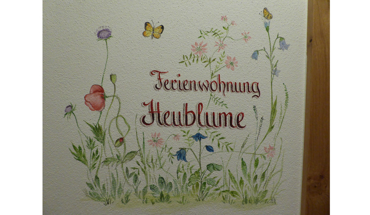 "Painting on the wall ""Ferienwohnung Heublume\"""