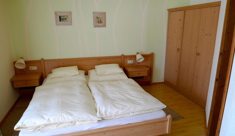 Bedroom of apartment 2 with double bed and large box