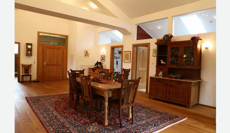 part of the living room, wooden furniture, carpet, table chairs