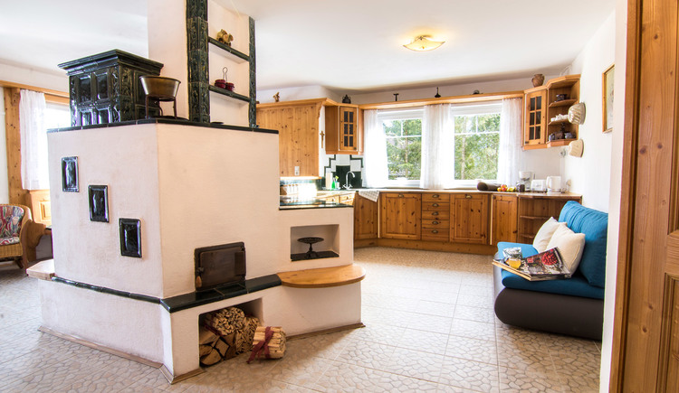 Fully equipped kitchen with wooden furniture and large picture window
