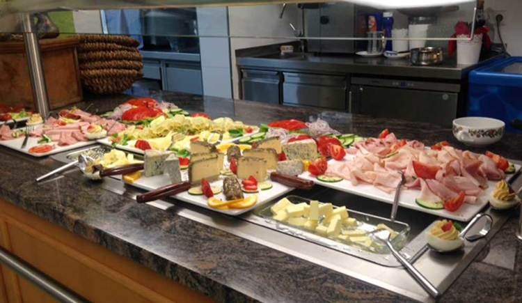 buffet with different sausauges and cheese