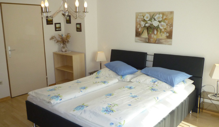 Spacious brightly furnished bedroom with double bed