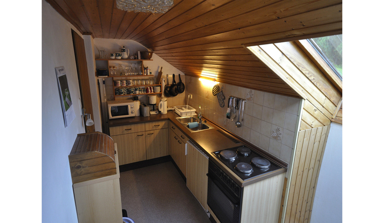 View in the kitchen with stove, sink, water cooker, coffee machine, microwave