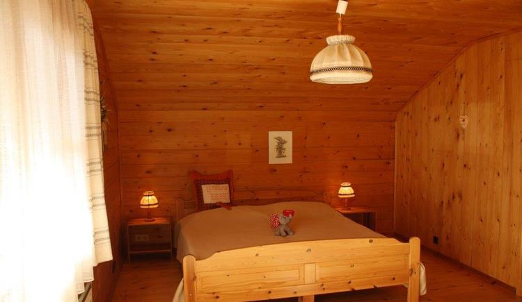 Traditionell eingerichtetes Doppelzimmer.