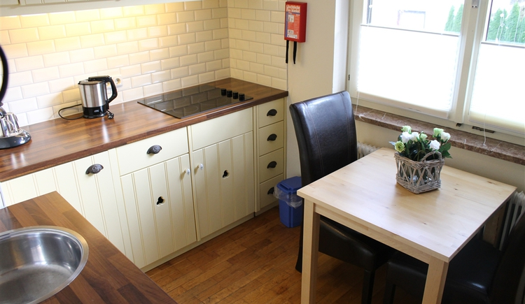 Fully equipped kitchen with small dining area
