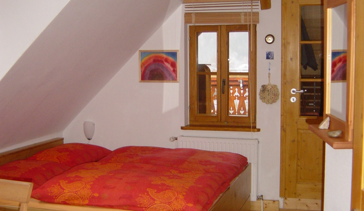 The bedroom of the Holiday flat with a comfortable double bed.