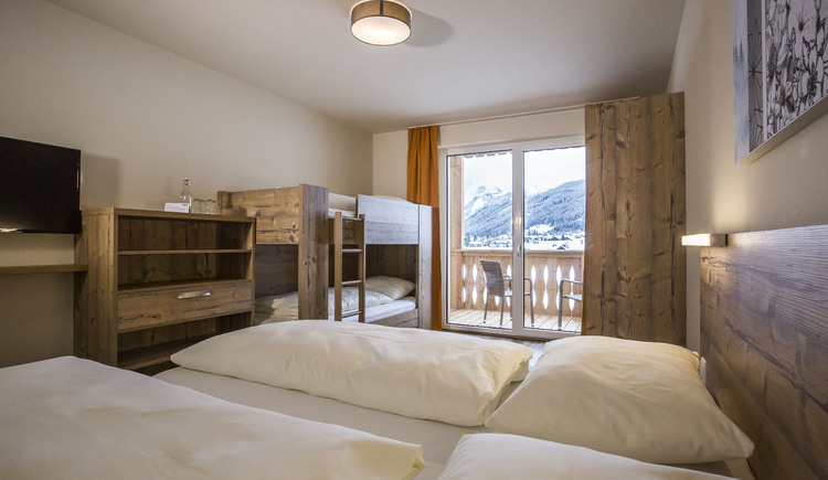 superior room with double bed and bunk bed