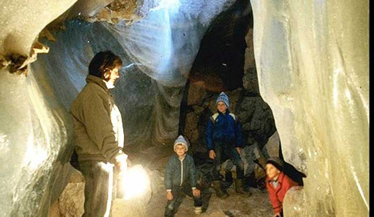 children on a guided tour in the ice cave