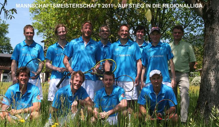 Tennis club team in the meadow