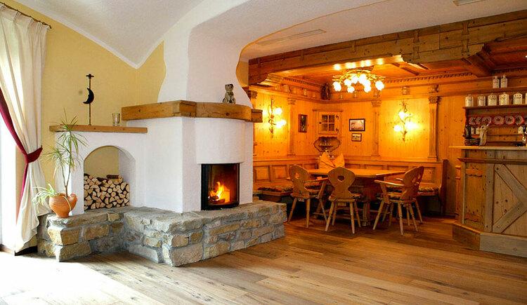 Fireplace room Hotel Eichingerbauer**** Superior (© Sabine Sperr)