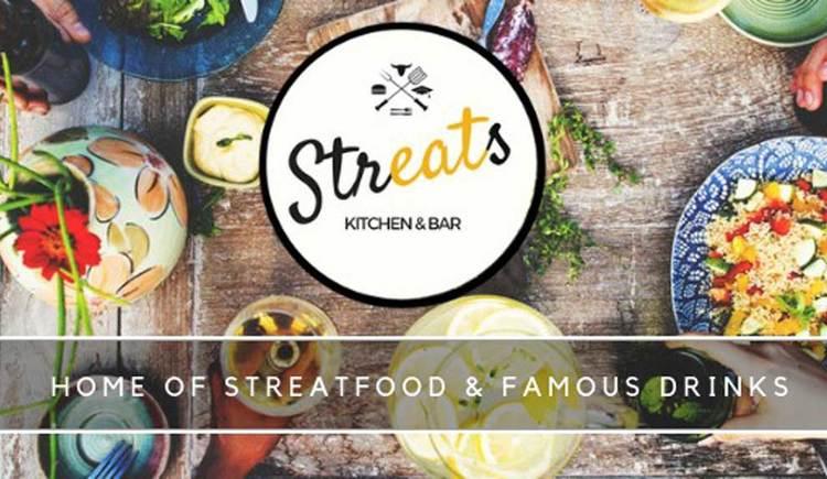 Das Logo von Streats Kitchen & Bar, ein Schriftzug, verschiedenste Gerichte und Dekorationen