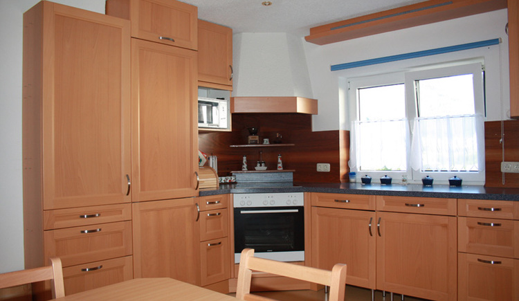 A fully equipped kitchen with oven and microwave