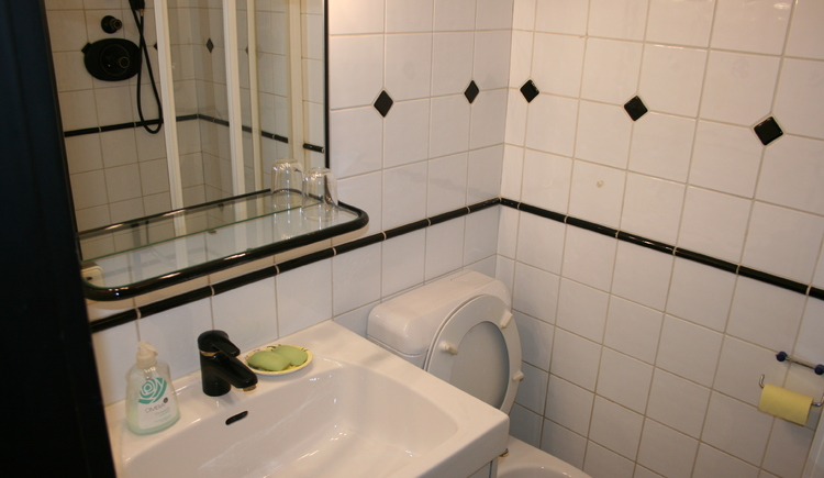 You will see the bathroom with washbasin and mirror. On the right side water closet.