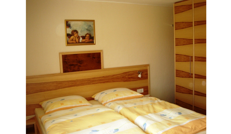 Bedroom with double bed, side wardrobe