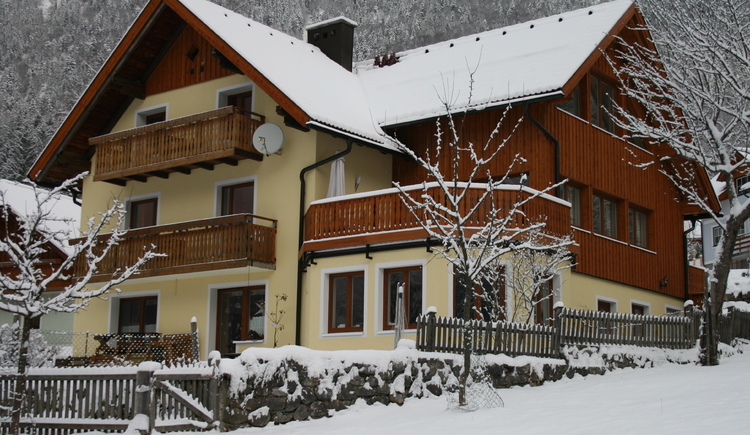 view of the house in winter