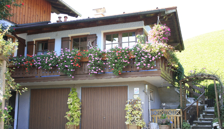 The apartment is accessible via a separate entrance and is decorated with lots of flowers