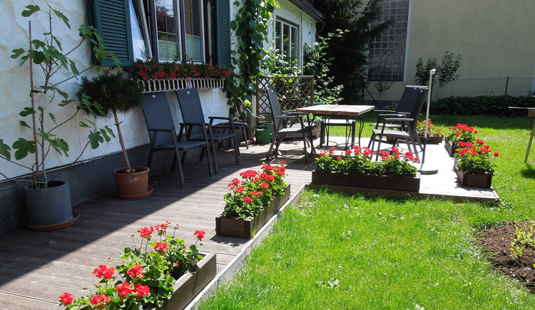 chairs and tables in the garden, flowers