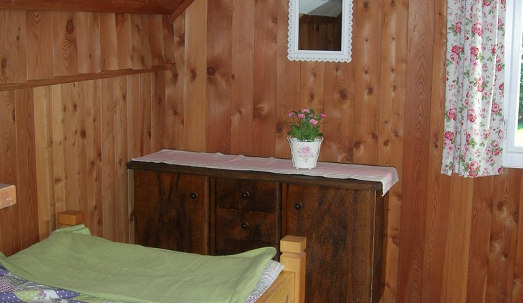 Small walk-through room on the 1st floor with single bed