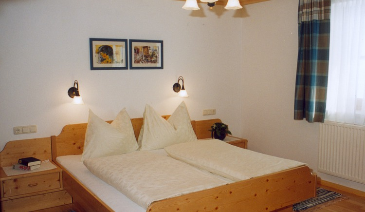 Double room with a huge bed on the upper floor