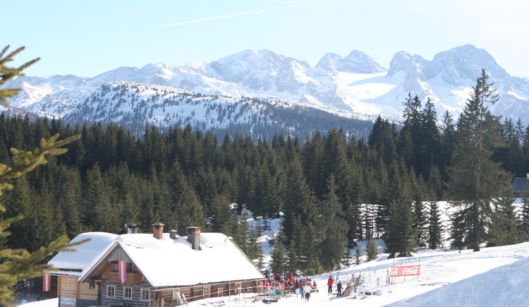 Winterpicture with a view of the Dachstein Glacier with the Zeishof hut.