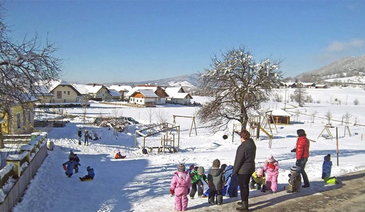 public playground from Innerschwand, playing children in the snow